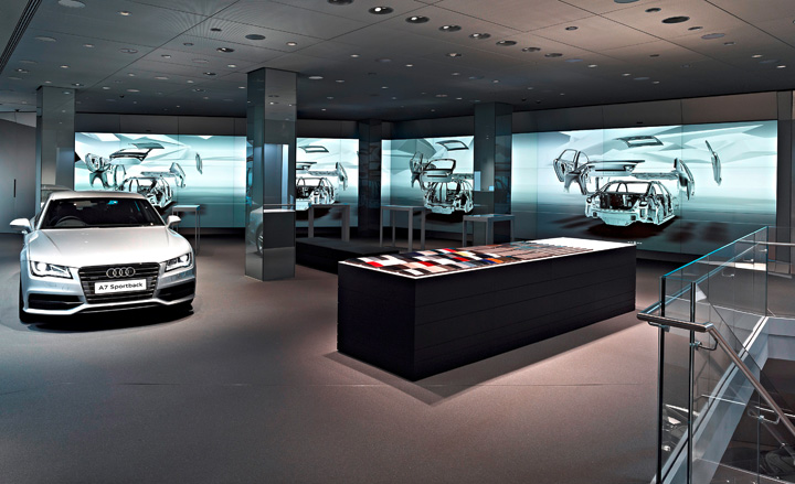 Silver Audi in a showroom